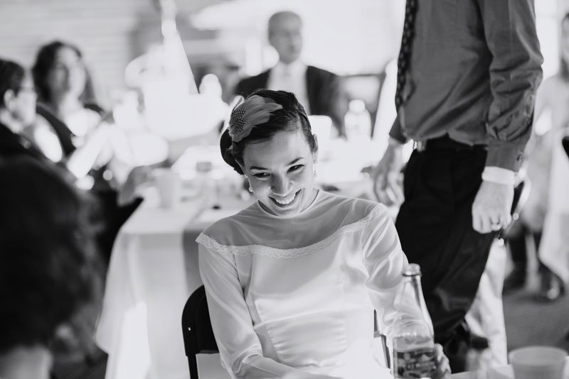 bride laughing during reception at arneson acres wedding