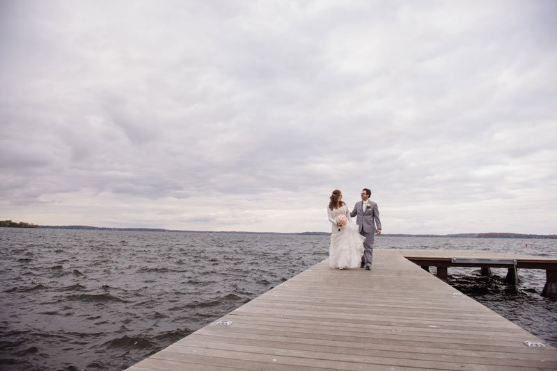 bride and groom on alumni pier at Madison terrace