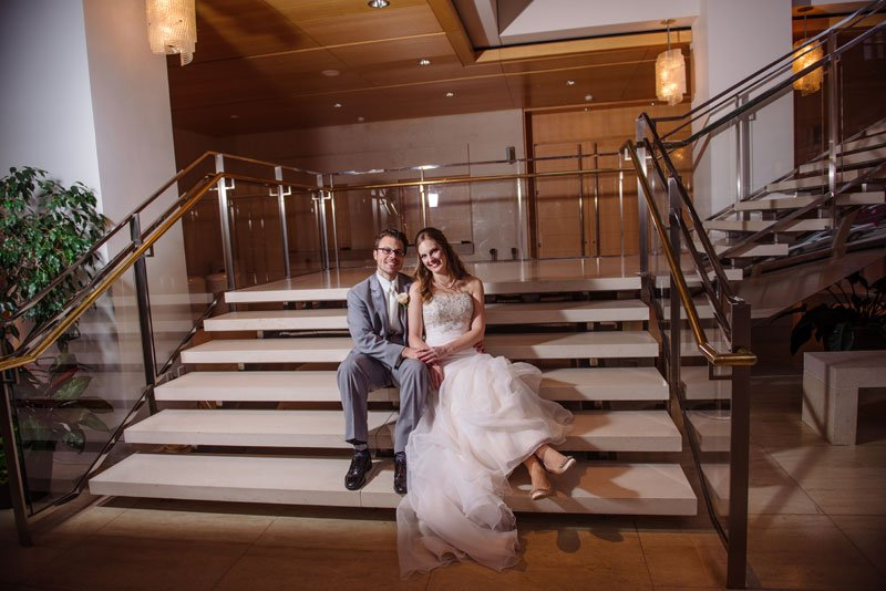 bride and groom on steps of overture center madison