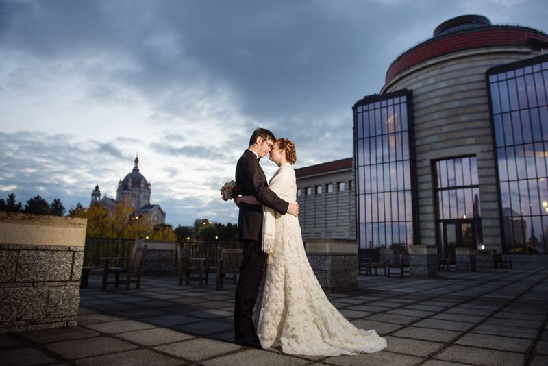 bride and groom outside mn history center