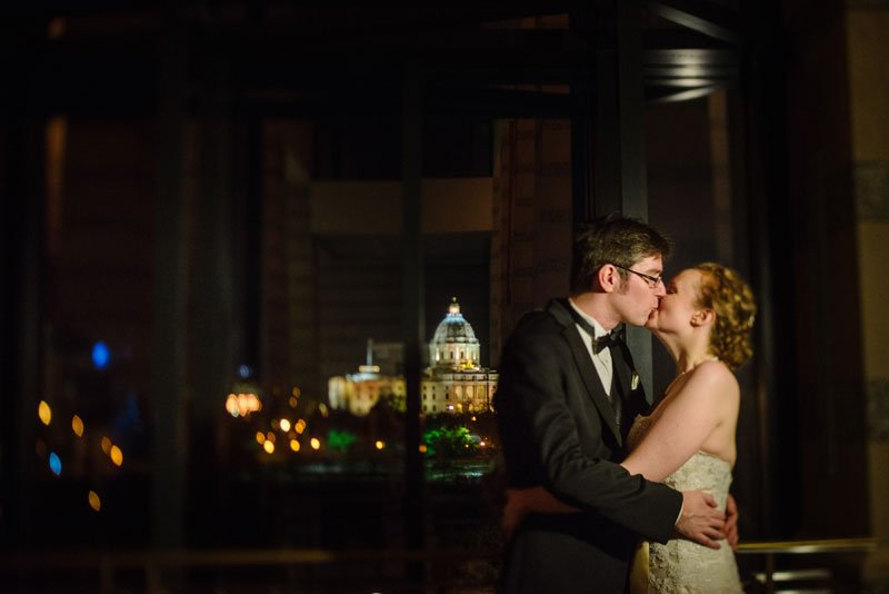 bride and groom at night with captiol in the background at mn history center