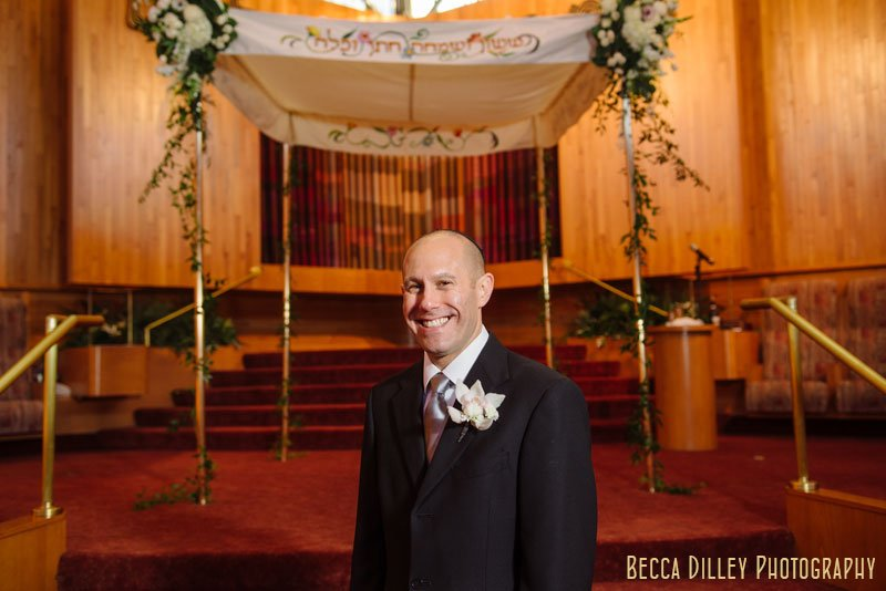 groom laughing at Beth El Synagogue in St Louis Park MN