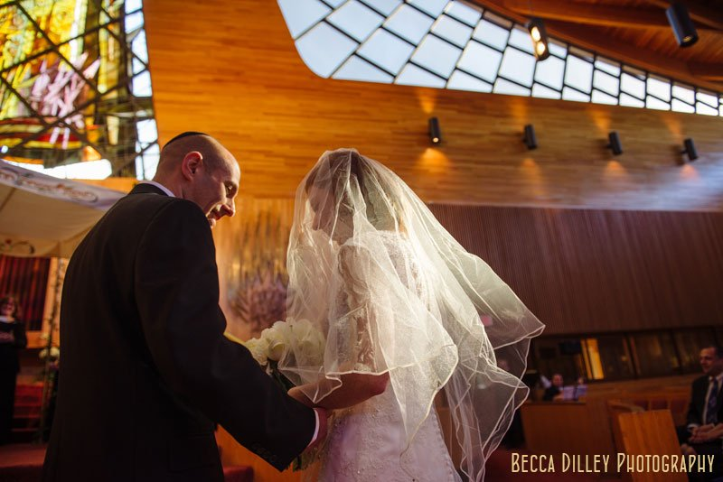groom meets bride at top of altar at Beth El Synagogue in St Louis Park MN