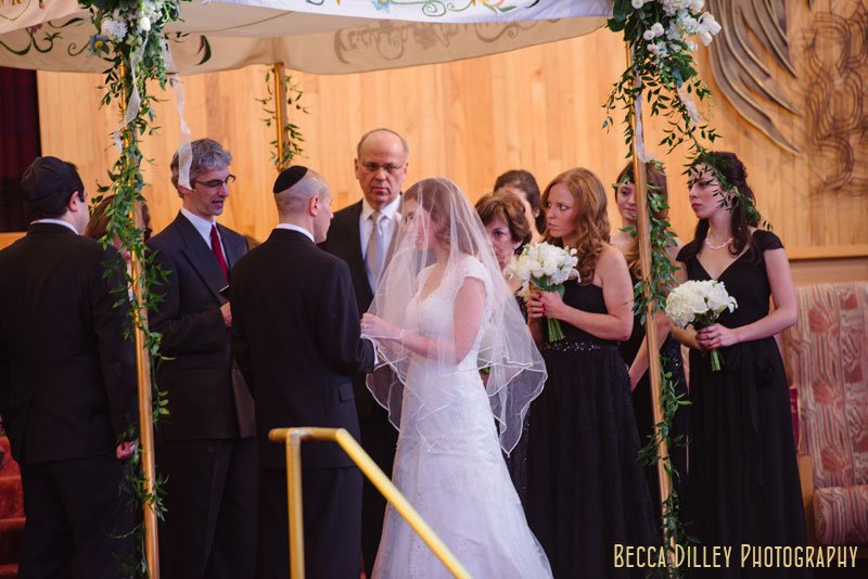 bride and groom exchange vows at Beth El Synagogue in St Louis Park MN