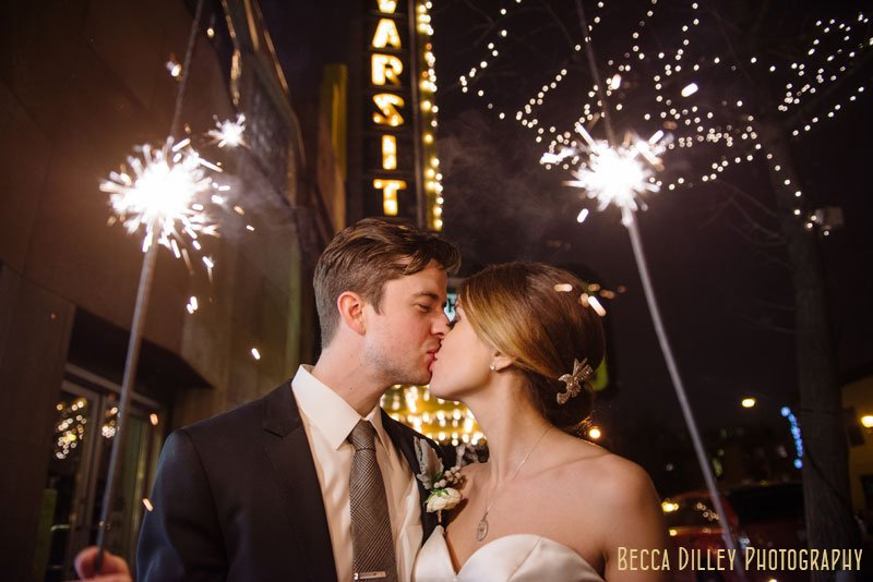 bride and groom with sparklers at varsity theater wedding