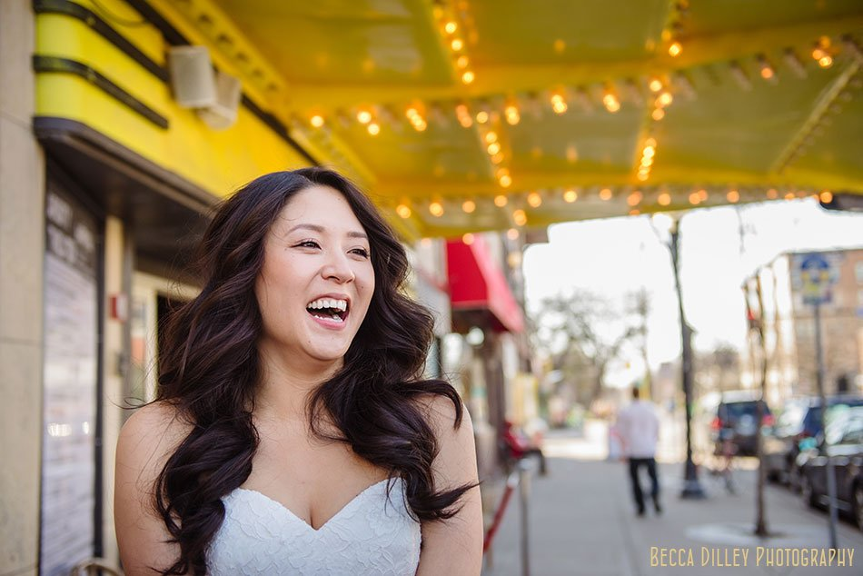 bride laughs under yellow marquee of Varsity Theater wedding Minneapolis