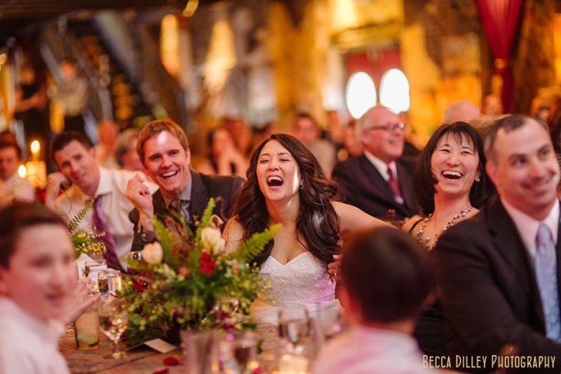 bride and groom enjoy toasts at Varsity Theater wedding Minneapolis