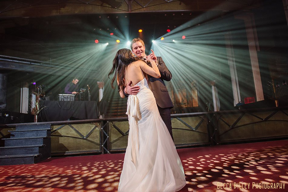 bride and groom first dance with dramatic lighting at Varsity Theater wedding Minneapolis