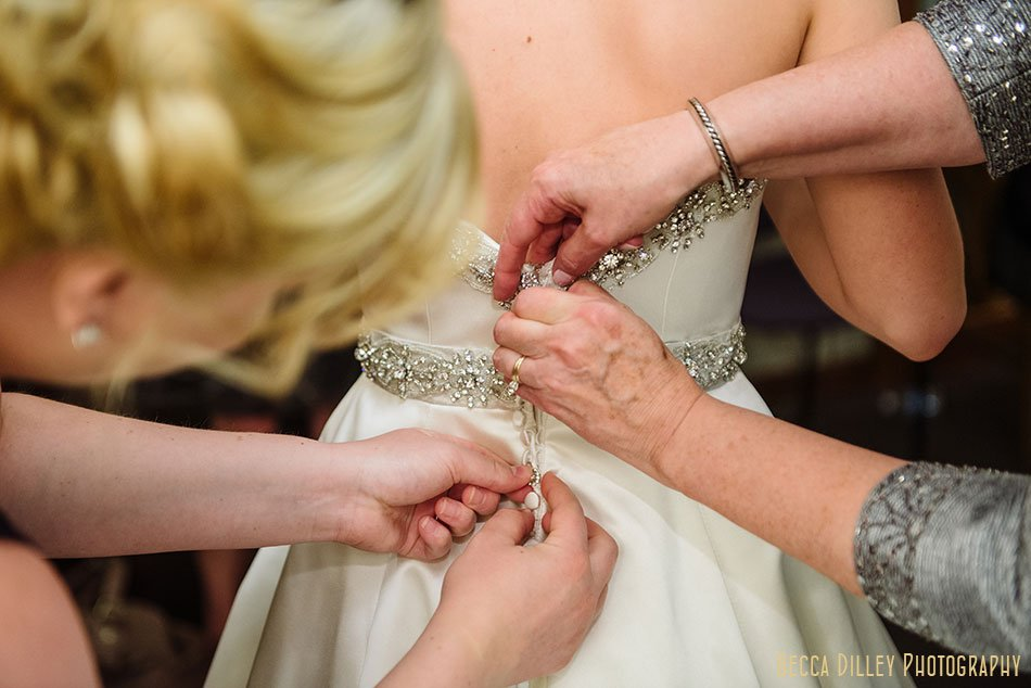 bride getting ready for basillica wedding minneapolis