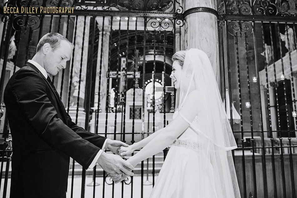 bride and groom see each other for first time at basillica wedding minneapolis