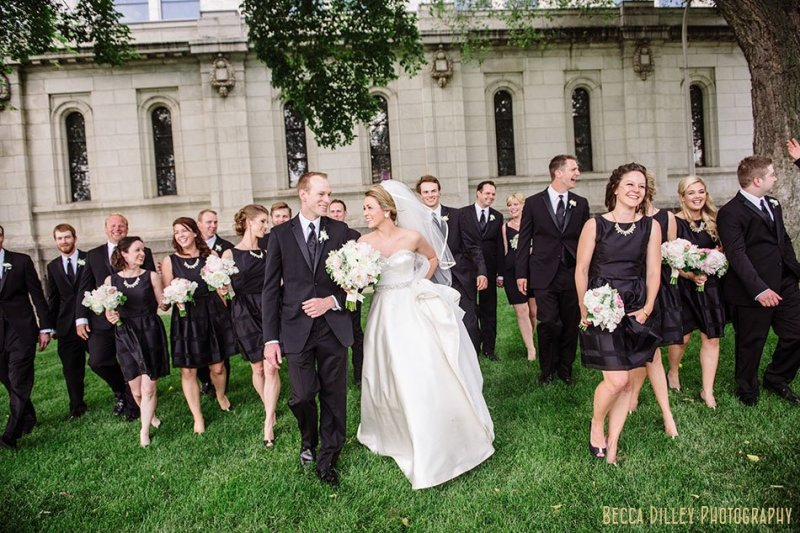 large wedding party walking outside basillica wedding minneapolis