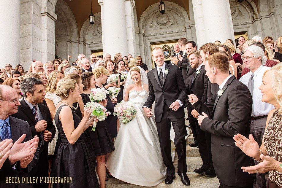 bride and groom exit basillica wedding minneapolis