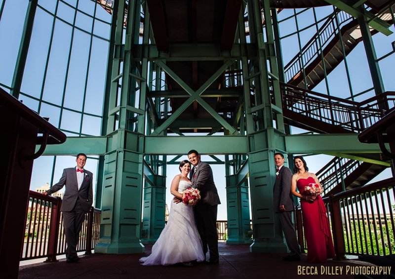 flash composite of wedding party on bridge at raspberry island st paul mn