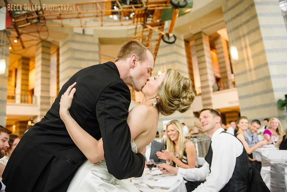 bride and groom kiss inside minnsota history center