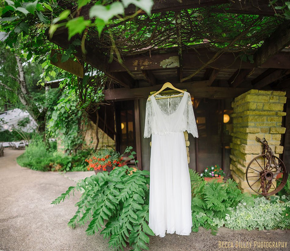panorama of wedding dress at hilltop in Spring Green WI