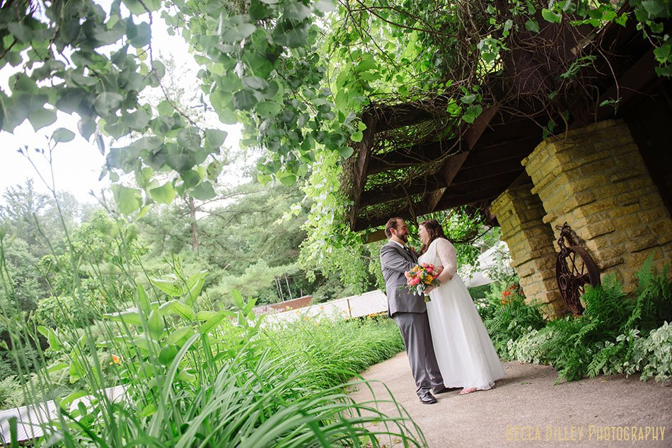 bride and groom at taliesen inspired buildings of hilltop in Spring Green WI