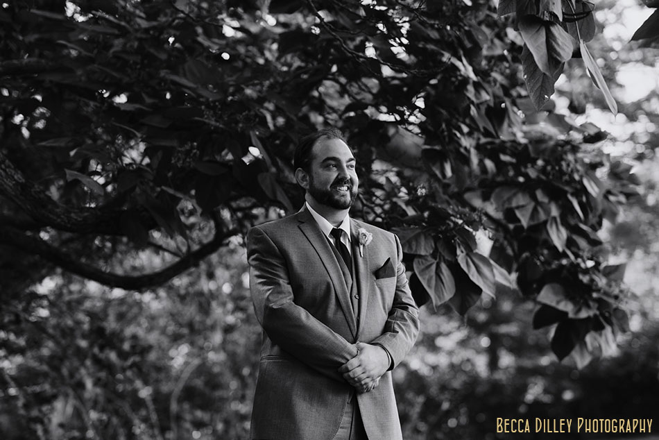 groom waits for bride before ceremony at hilltop in Spring Green WI