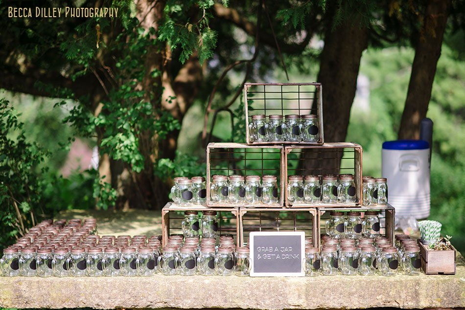 chalk paint mason jar cups for outdoor wedding at hilltop in Spring Green WI