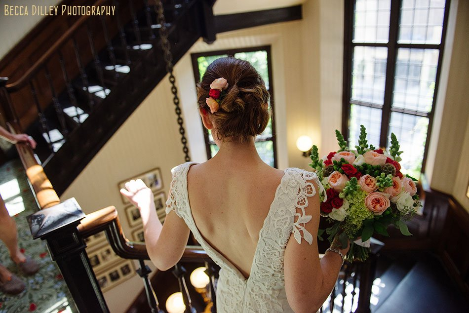 bride goes down stairs to meet groom at minneapolis club wedding