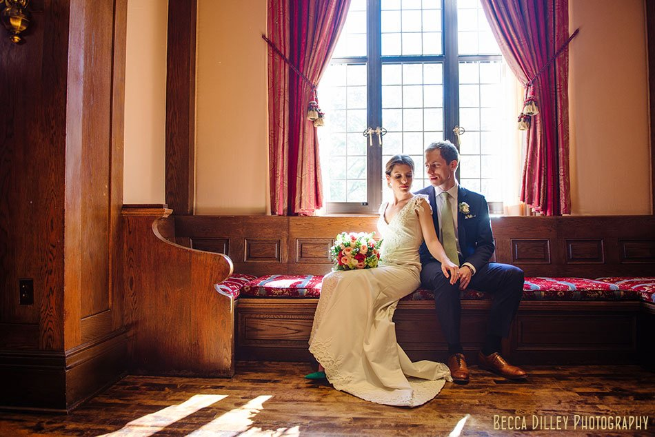 bride and groom in window seat at minneapolis club wedding