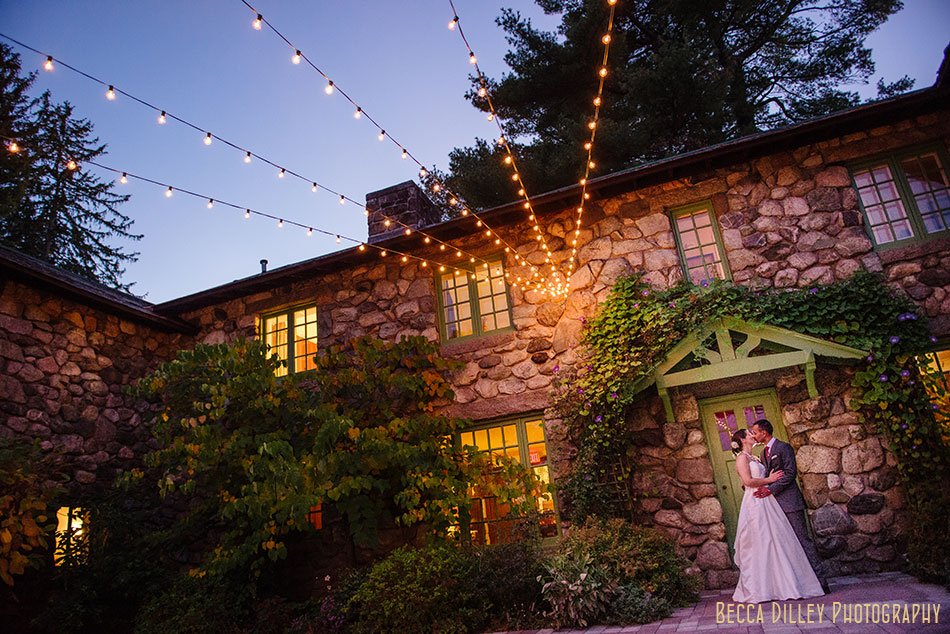 bride and groom under lights at at Willowdale Estate in Topsfield MA