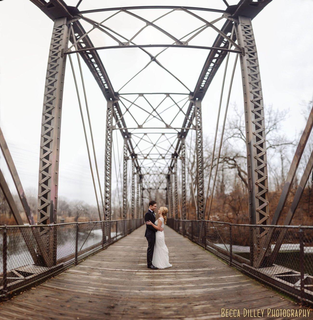 best minneapolis wedding photographer panorama of bride and groom on bridge