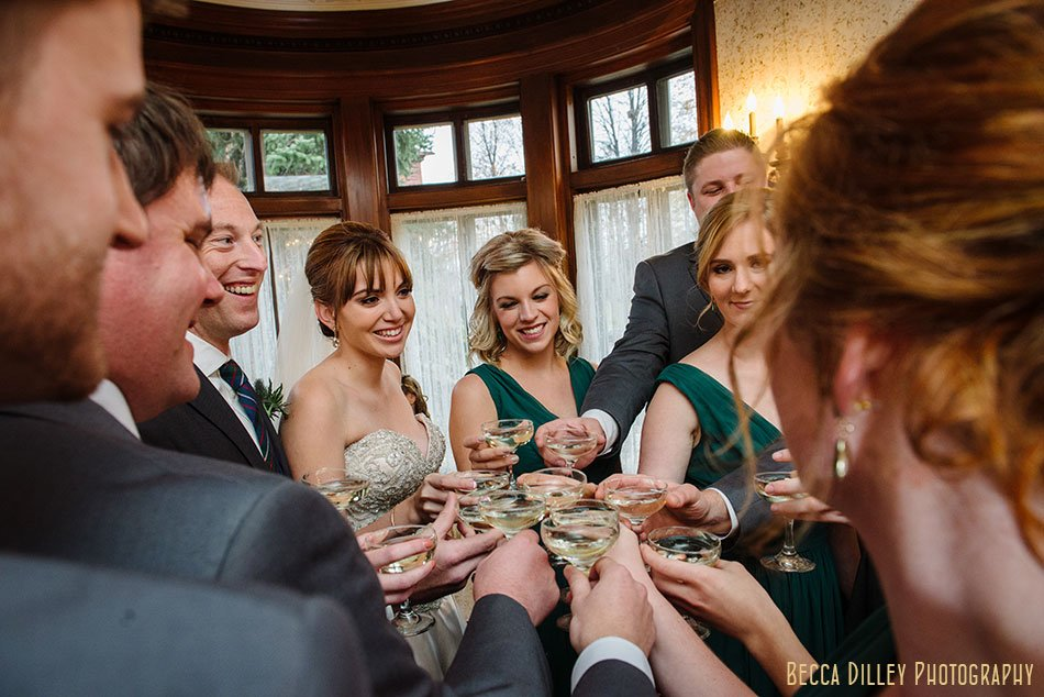 wedding party toasts minneapolis wedding at gale mansion
