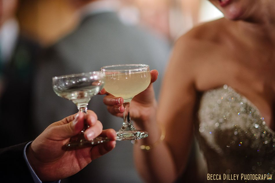bride with french 75 cocktail minneapolis wedding at gale mansion