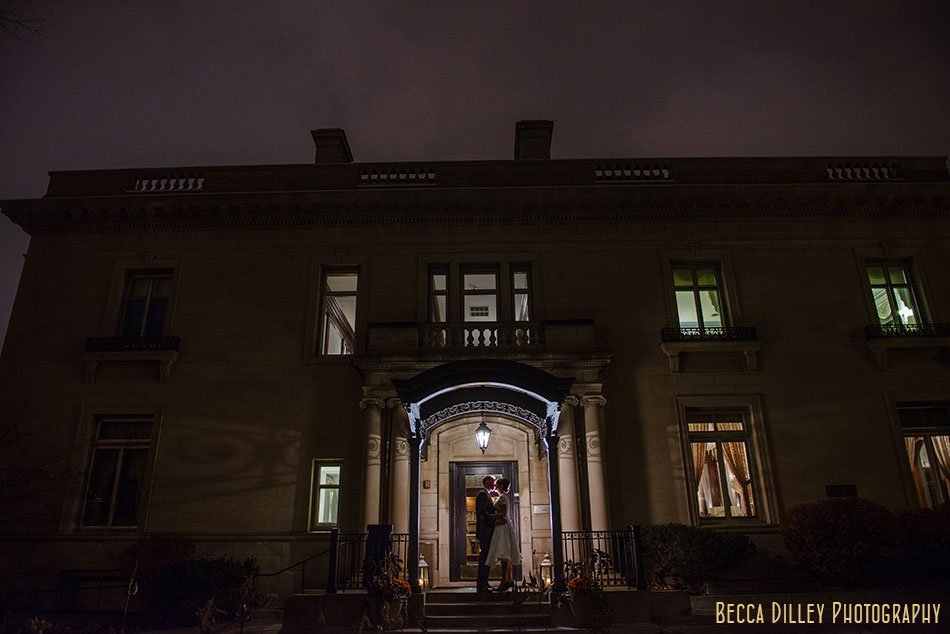 dramatic photo of bride and groom at night outside minneapolis wedding at gale mansion