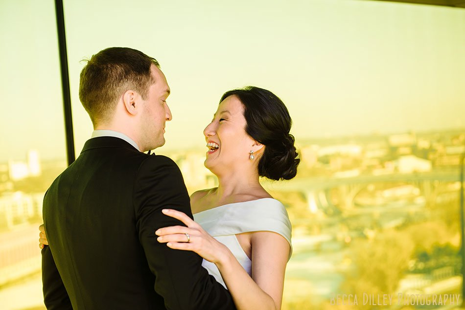 Couple laugh and embrace during first look at guthrie theater