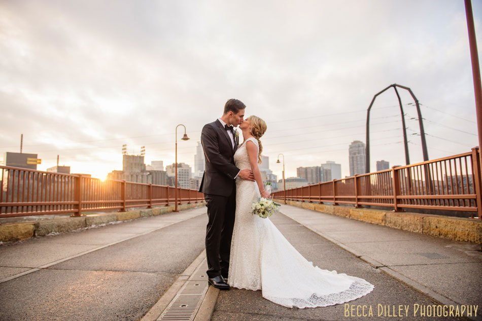 stone arch bridge wedding photos at dusk