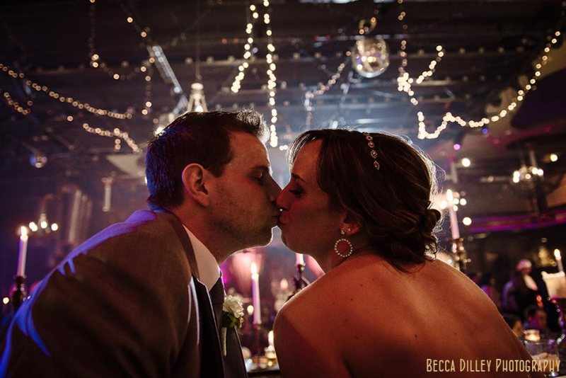 bride and groom kiss minneapolis wedding photographer varsity theater april mn