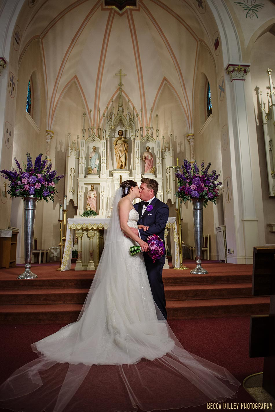 bride and groom on steps of church madison wisconsin wedding