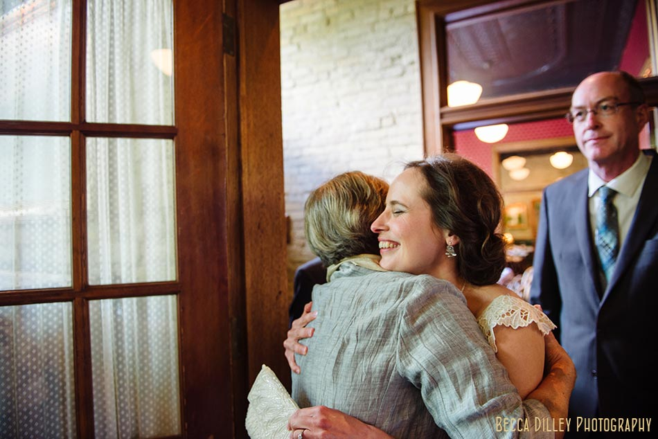 bride hugs mom