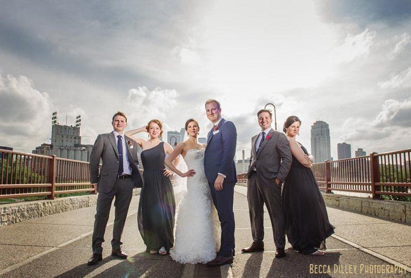 flash composite wedding party on stone arch bridge with skyline campus club of mn wedding