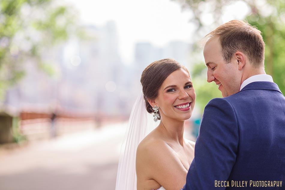 minneapolis wedding photographer couple at stone arch bridge