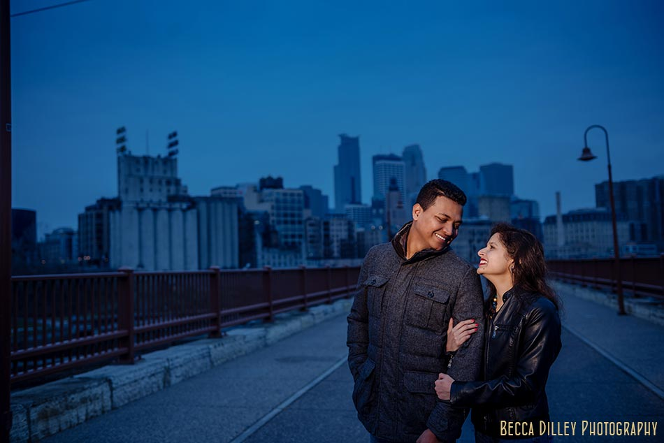 minneapolis wedding photographer engagement photos at stone arch bridge in winter