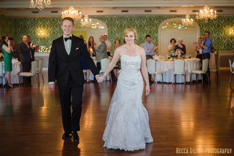 bride and groom enter Minikahda Club wedding minneapolis