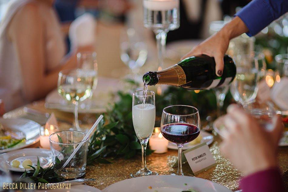 pouring champagne Minikahda Club wedding minneapolis