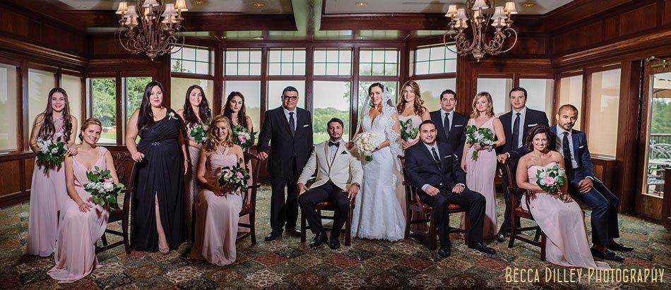 dramatic flash composite portrait of large wedding party wayzata country club wedding mn