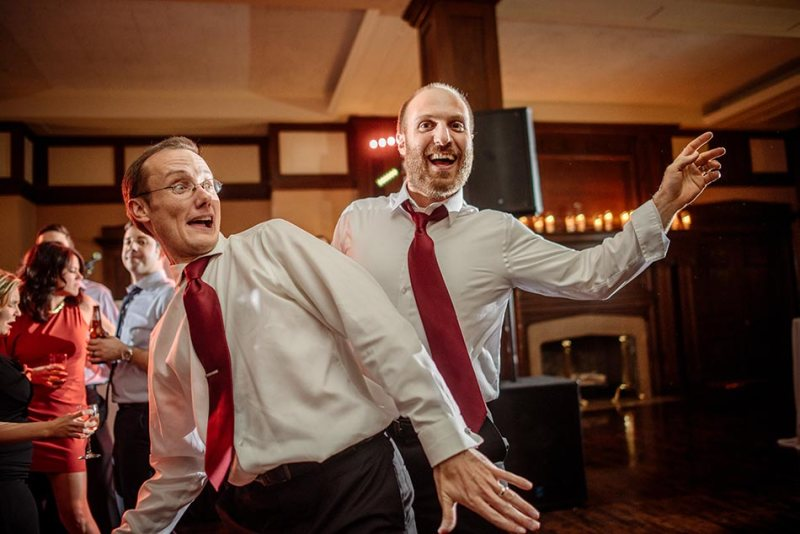 gromsmen dancing at minneapolis club wedding