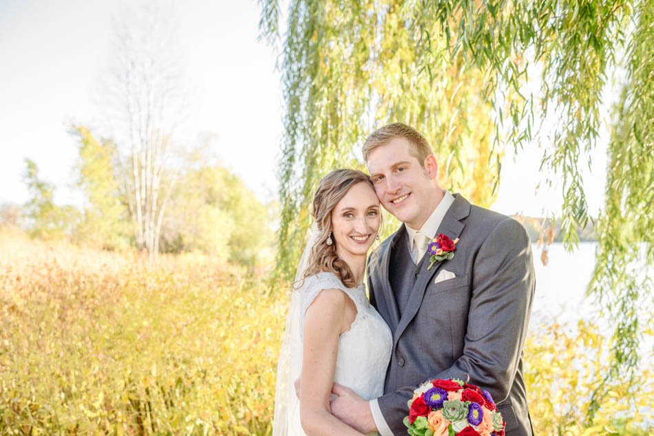minneapolis wedding photographer bride and groom with willow tree lake of the isles