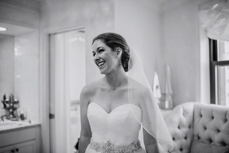 bride smiling St Paul Hotel winter wedding mn
