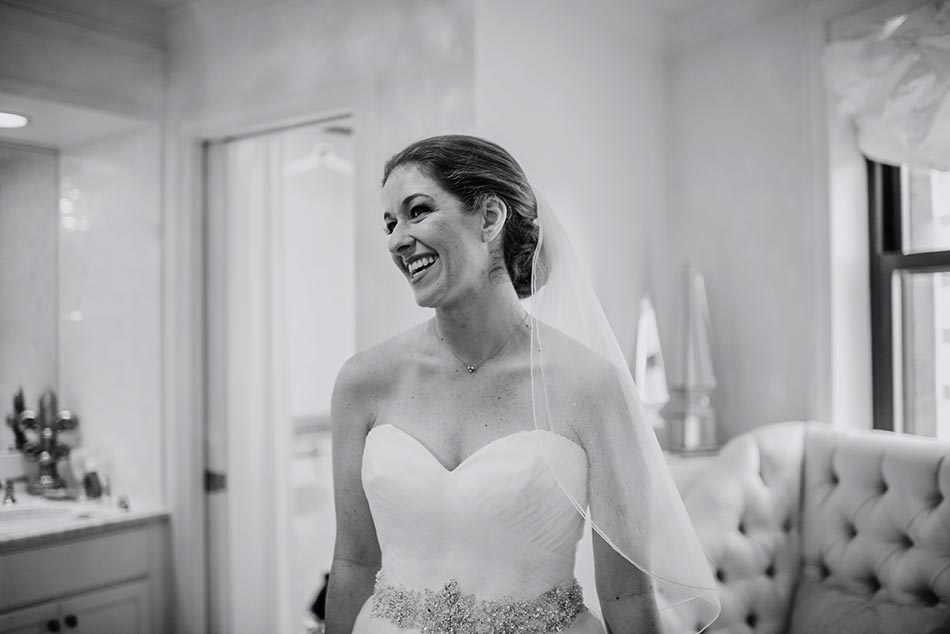 bride smiling St Paul Hotel winter wedding mn