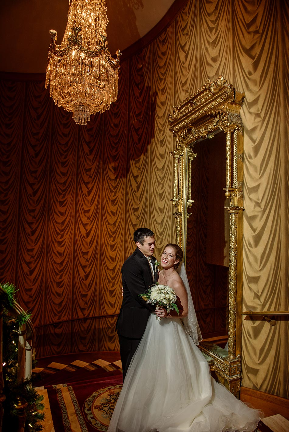bride and groom on dramatic staircase at St Paul Hotel winter wedding mn