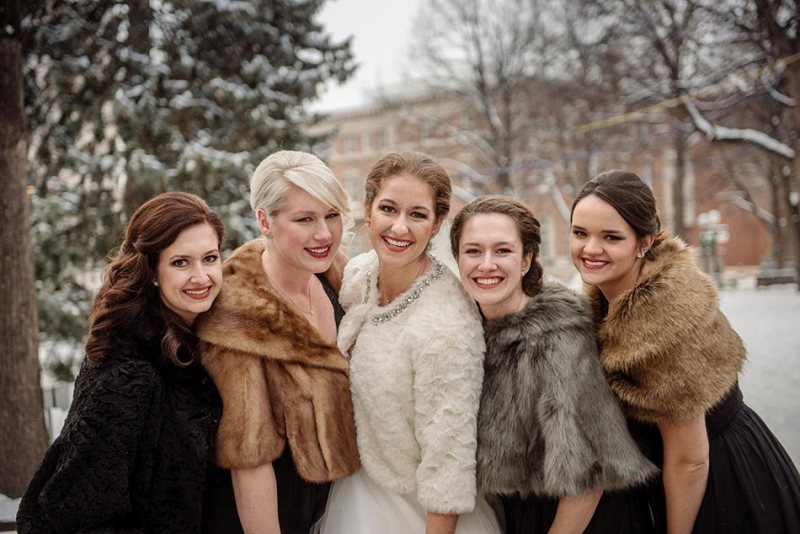 bridesmaids with fur jackets St Paul Hotel winter wedding mn