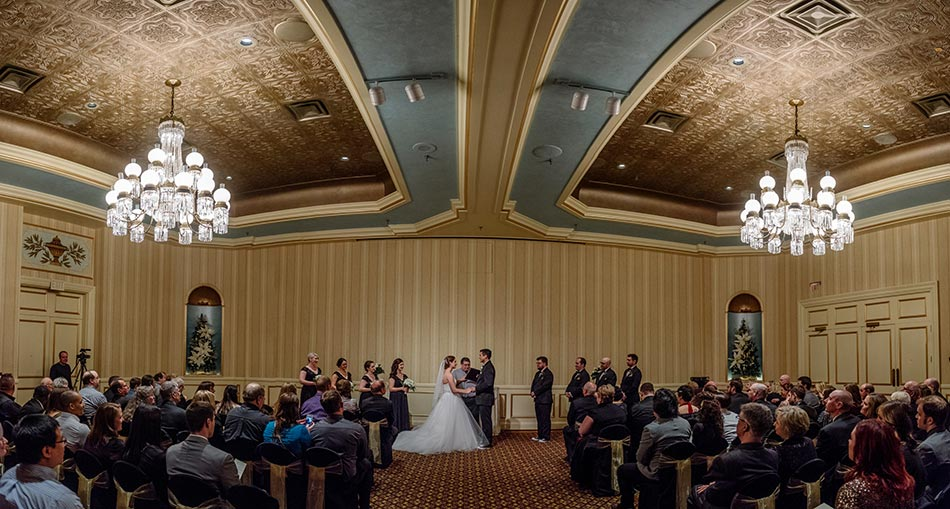 panorama of wedding ceremony St Paul Hotel winter wedding mn