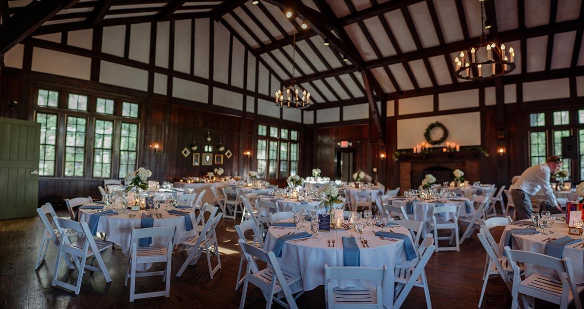 interior of reception set up for wedding dinner Theodore Wirth Chalet Wedding