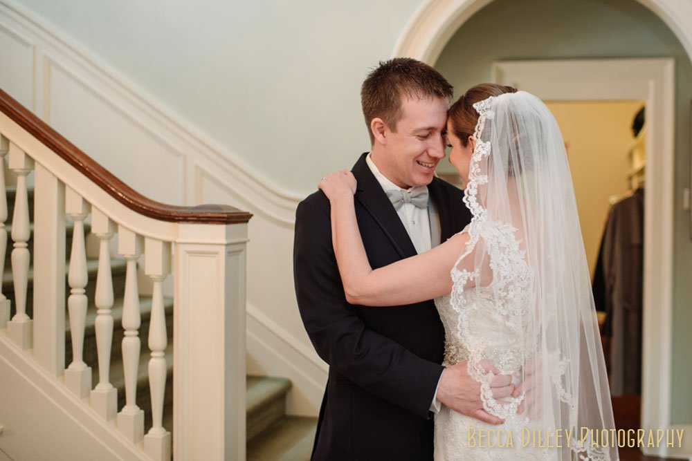Bride and groom embrace during a first look at the St Paul College Club