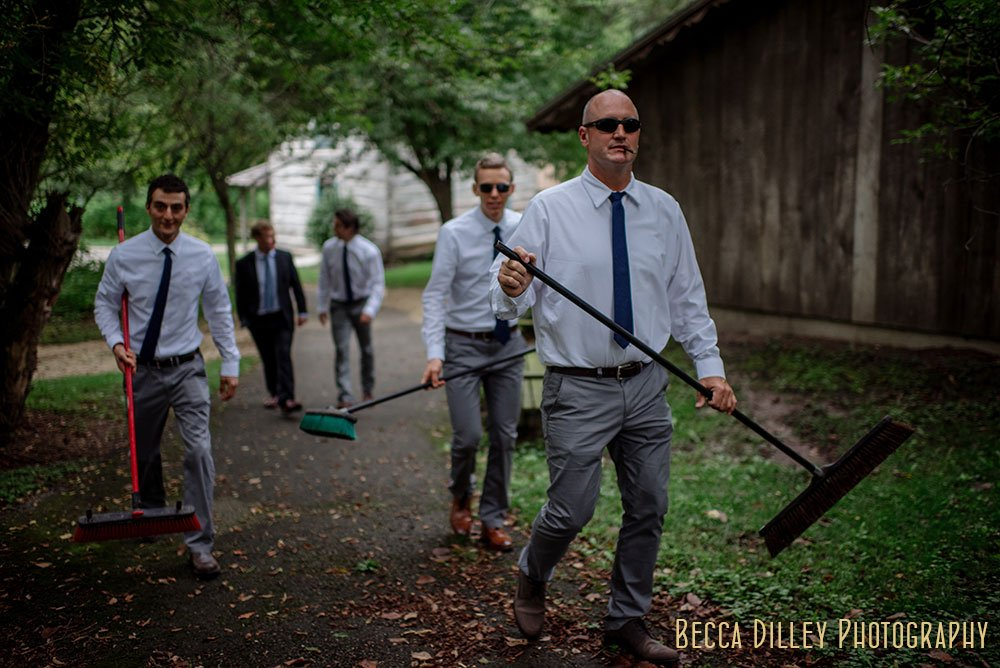 groomsmen cleaning up Norskedalen driftless WI wedding